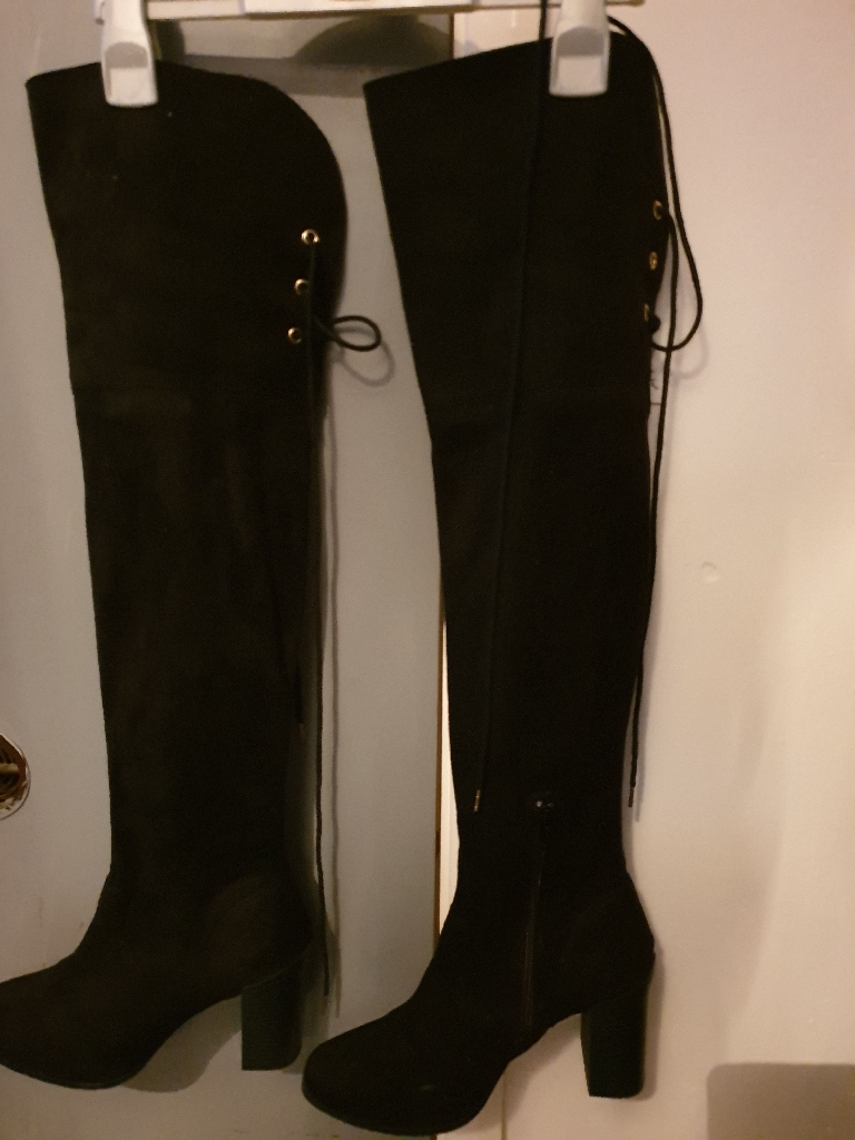 Black knee length boots