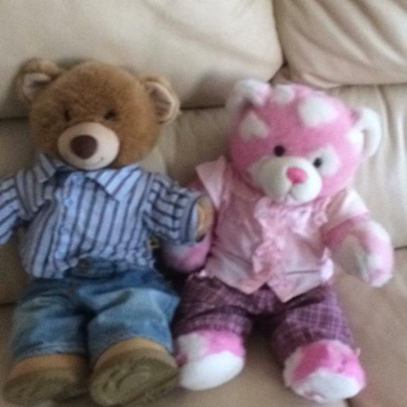 Boy and girl build a bear with cloves