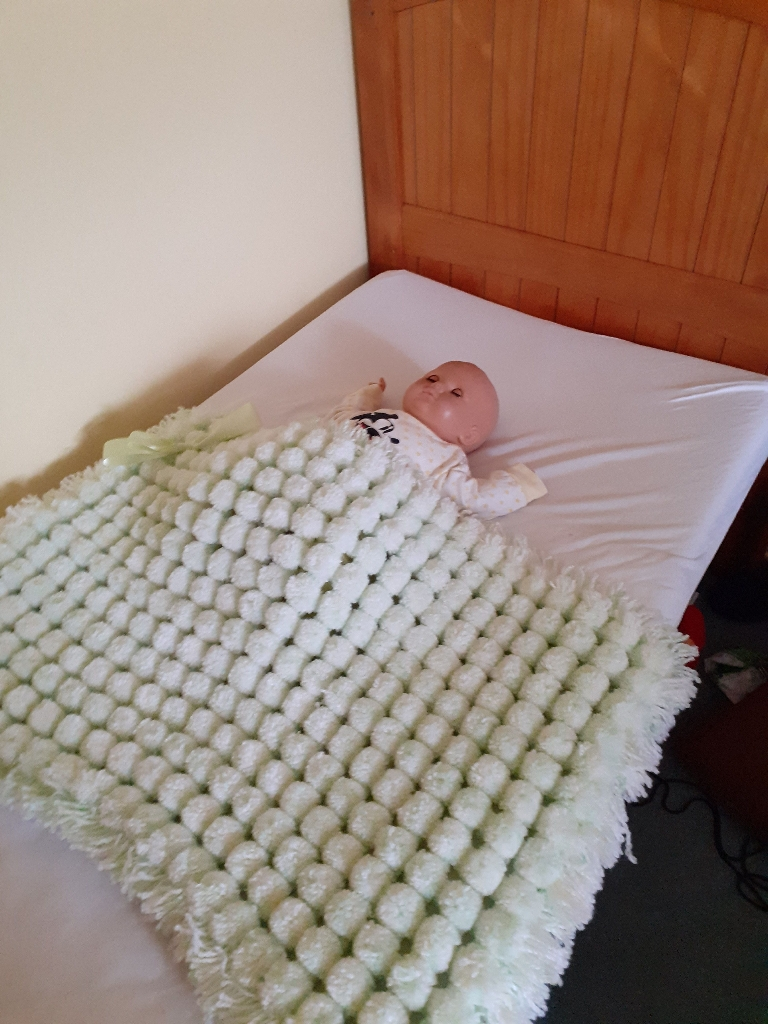 Handmade knitted pom pom blankets for moses baskets and carseat each