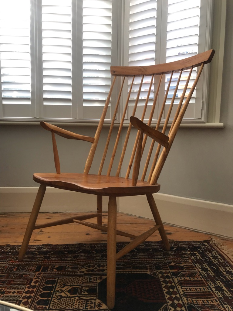 Wooden mid century modern armchair with high back