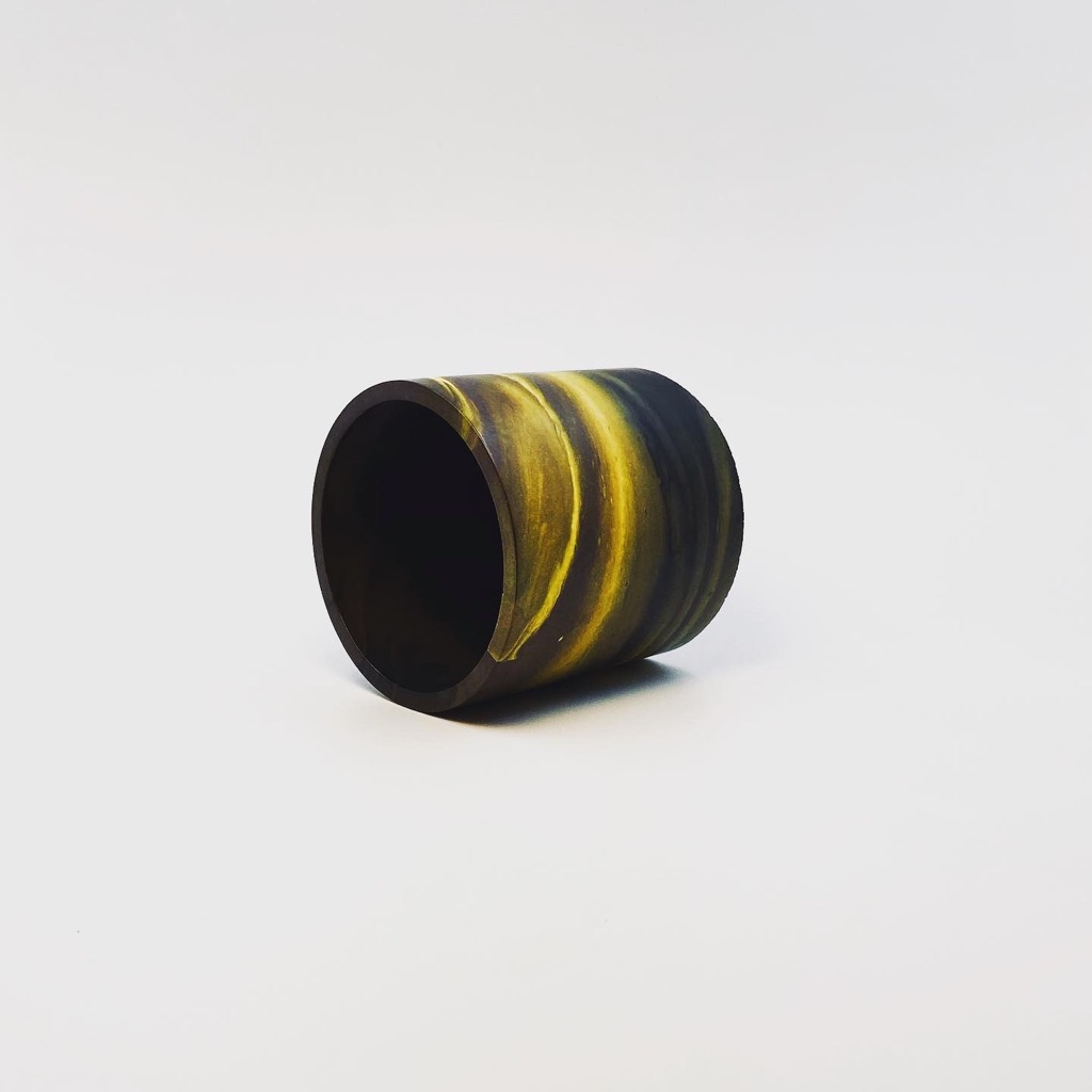 Black and yellow Jesmonite circular pot/planter