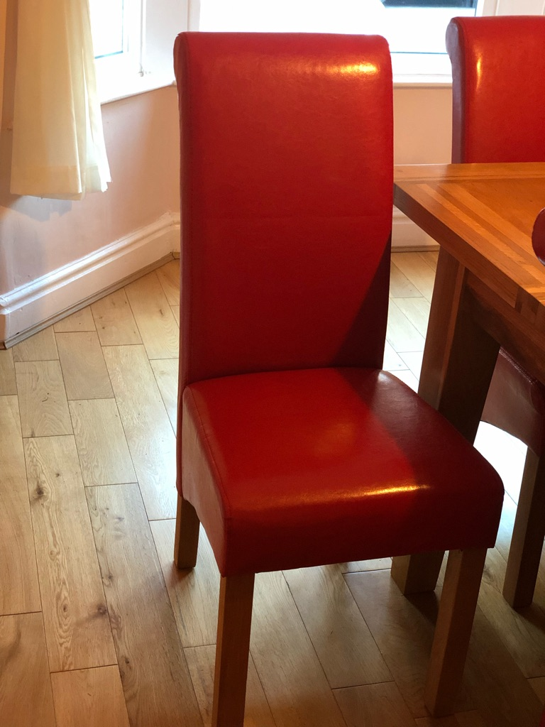 Red faux leather dining chairs x 6