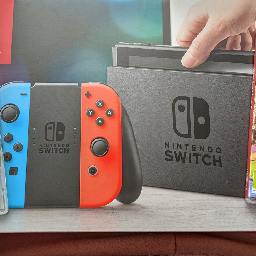 Nintendo Switch + Super Mario Party & Mario Kart 8 Deluxe.
