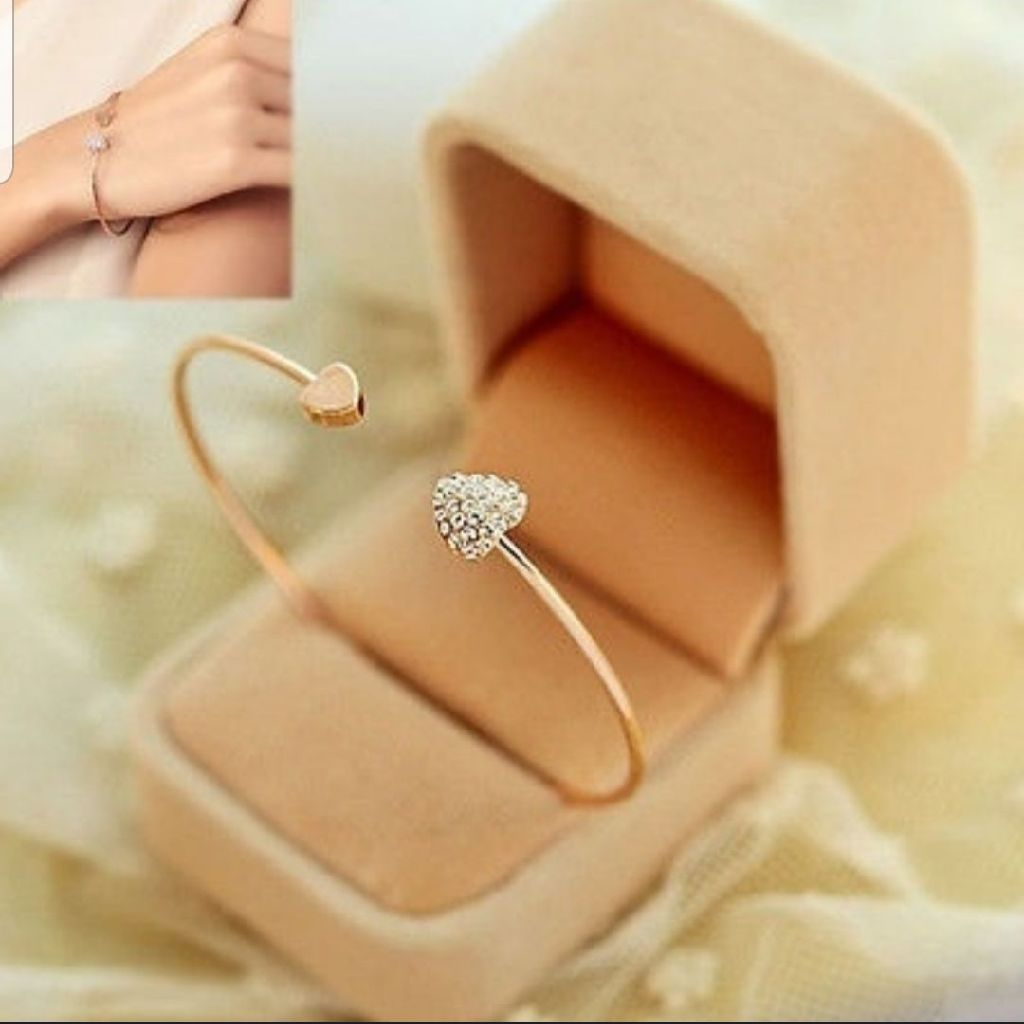 Bn cute rose gold bangle with delicate silver heart.