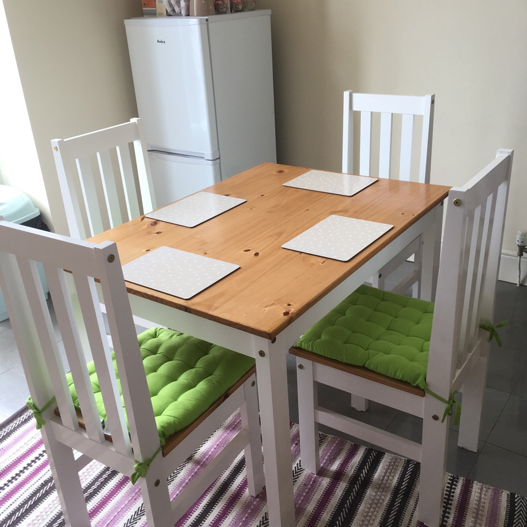 Wooden dining table and four chairs