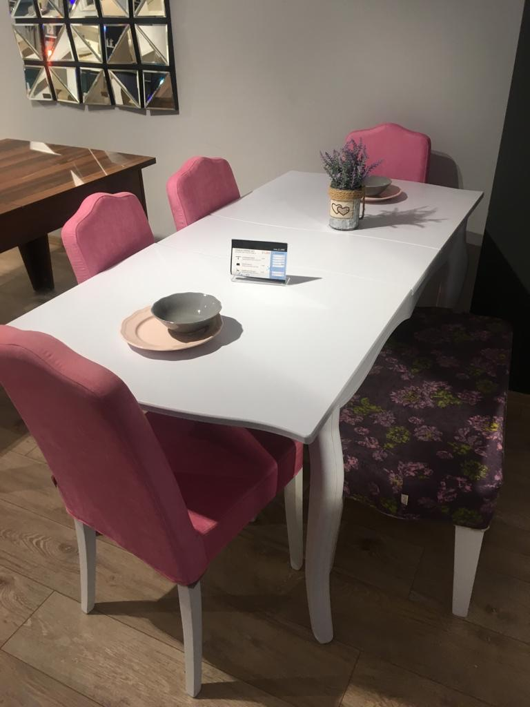 White wood dining table with 4 chairs and a bench