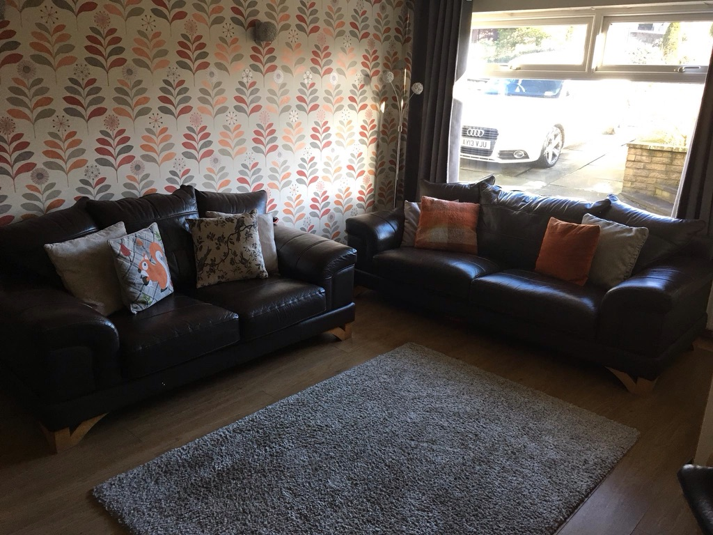 Brown leather sofas and chair