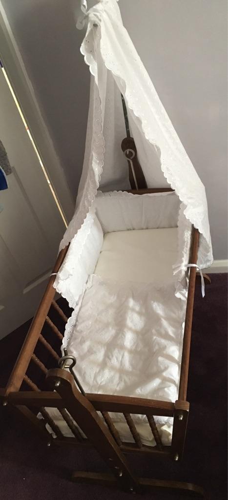 Rocking crib with drapes