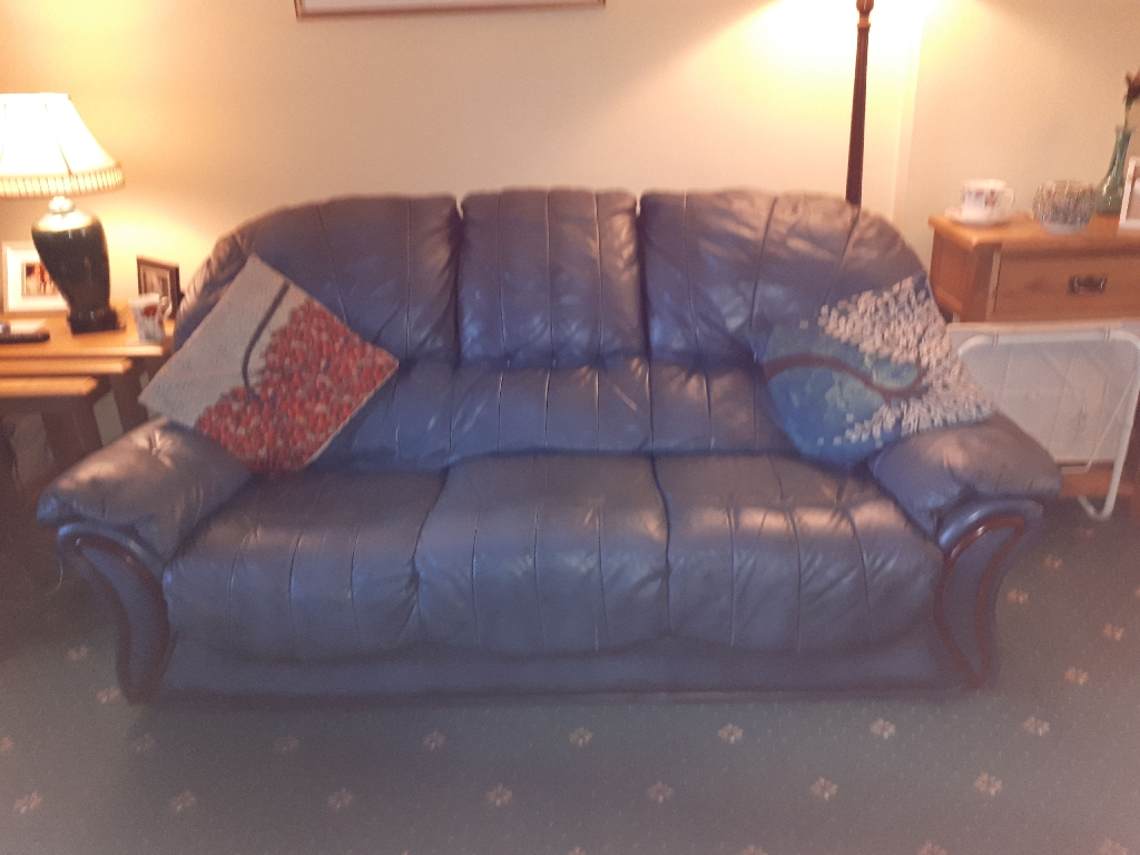 Leather three seater sofa and Two Arm Chairs