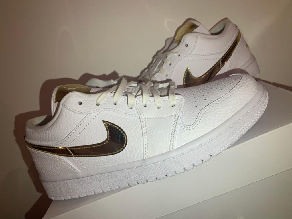 Jordan 1 low white and gold shiny swoosh