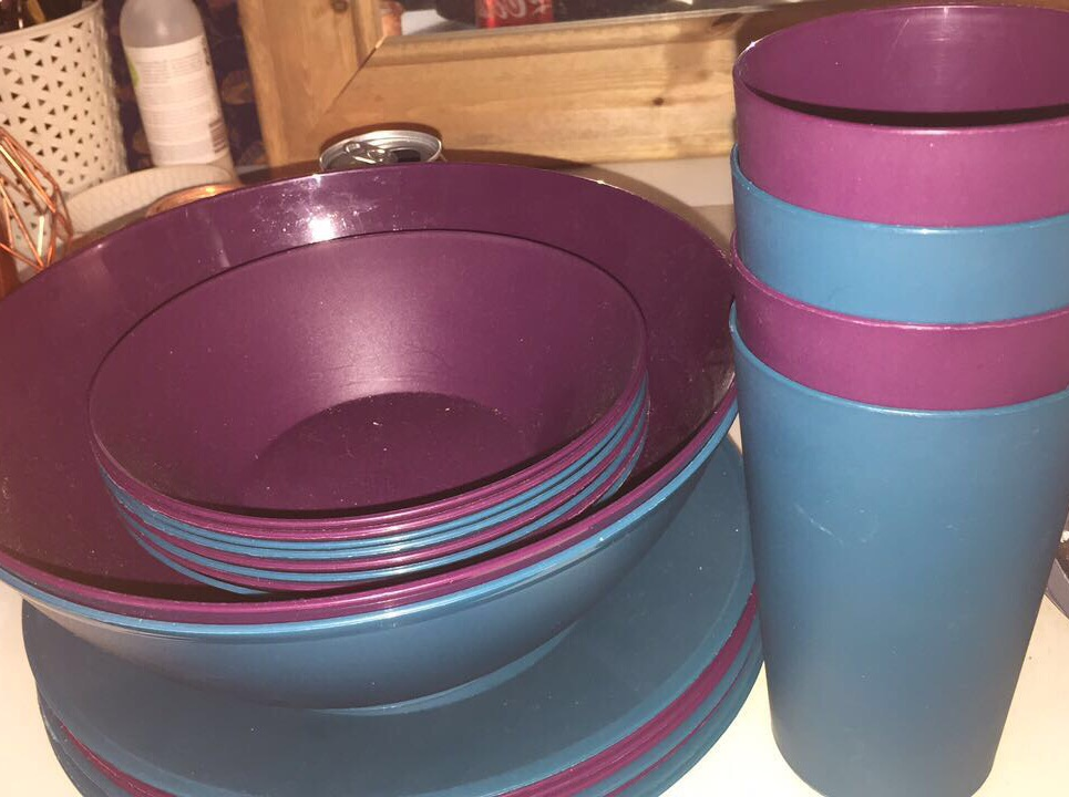 Purple and green bowls plates and cups.