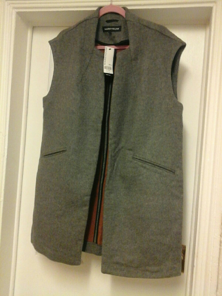 Warehouse sleeveless coat. Grey and half lined in tan.