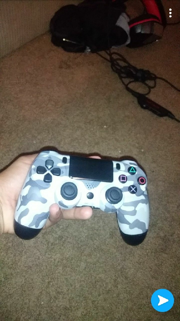 White and black camouflage PS4 controller