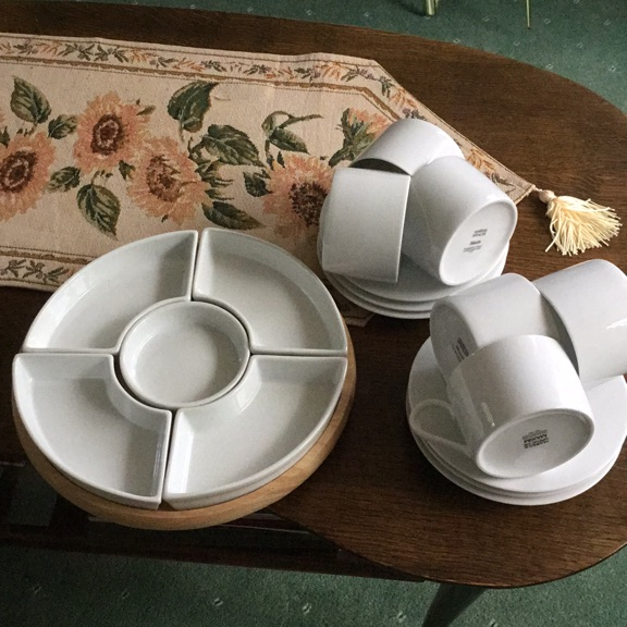 Six marks and Spencer's teacups and saucers plus lazy Susan