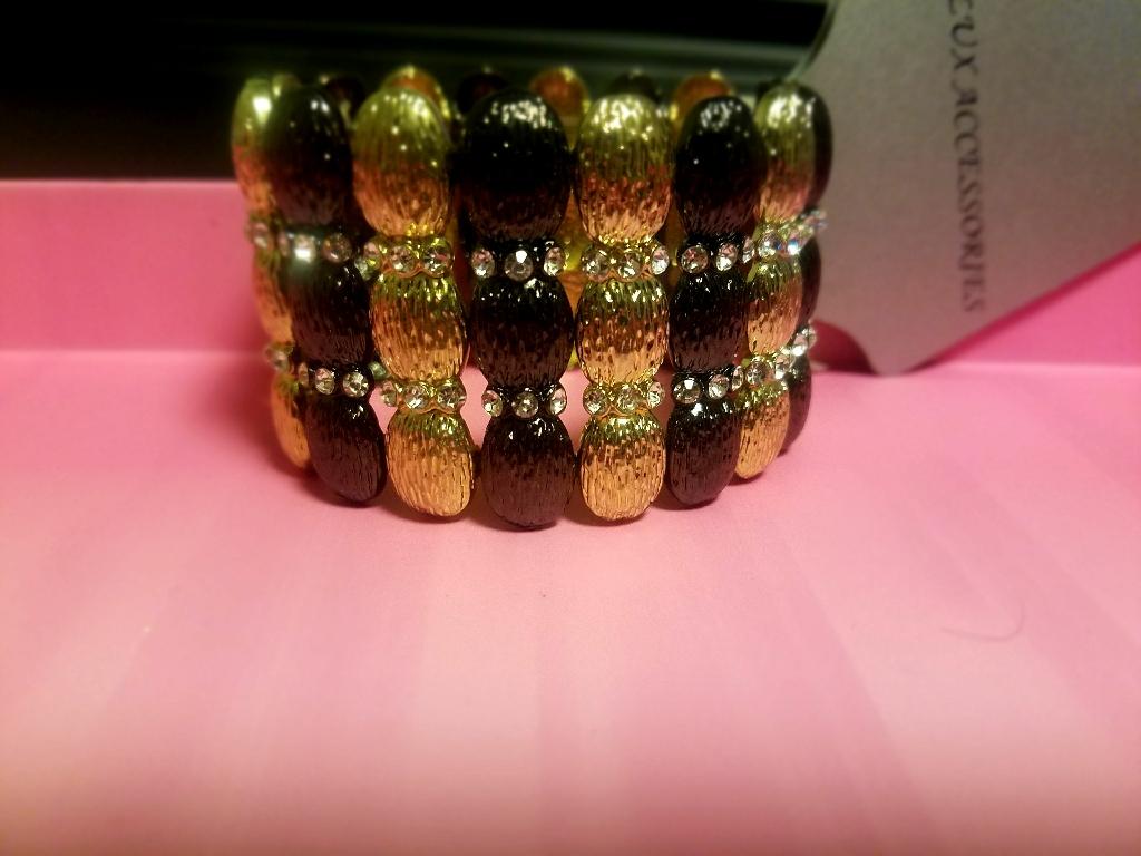 Black gold tone rhinestone bracelet