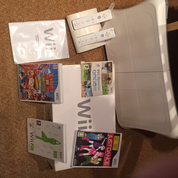 WII console, board and 4 games