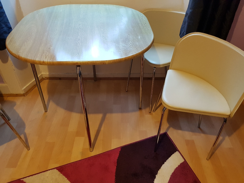 The table and 3 chairs