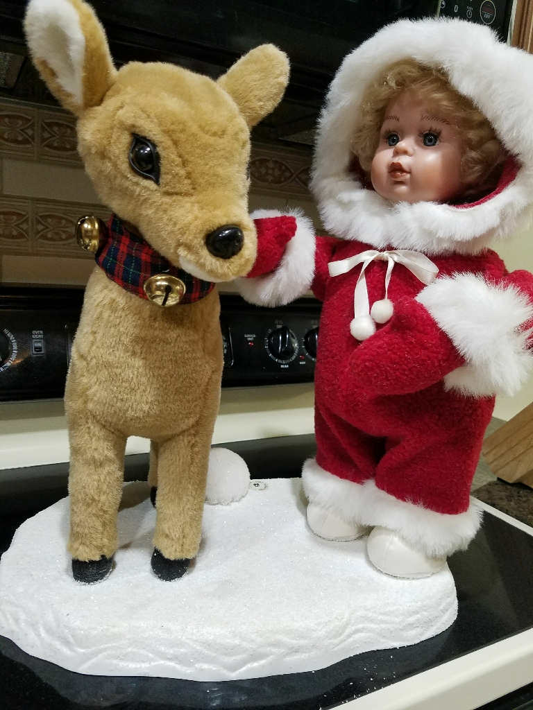 A little girl in the snow with her buddy. Price drop