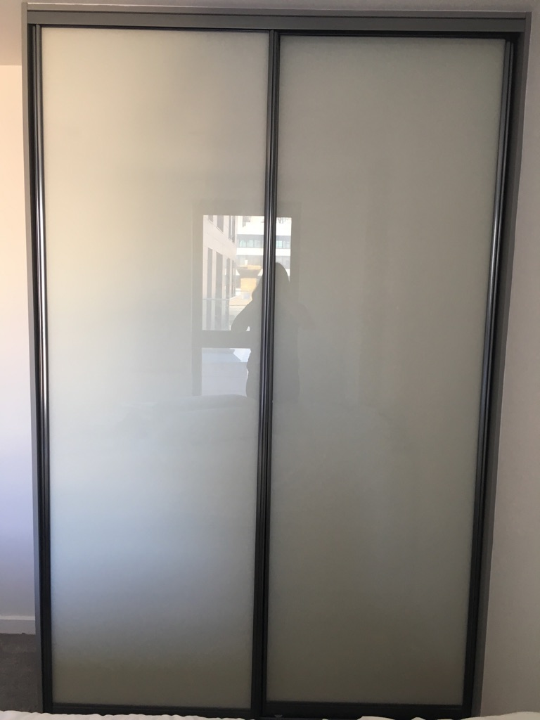 Grey wall to ceiling cupboard