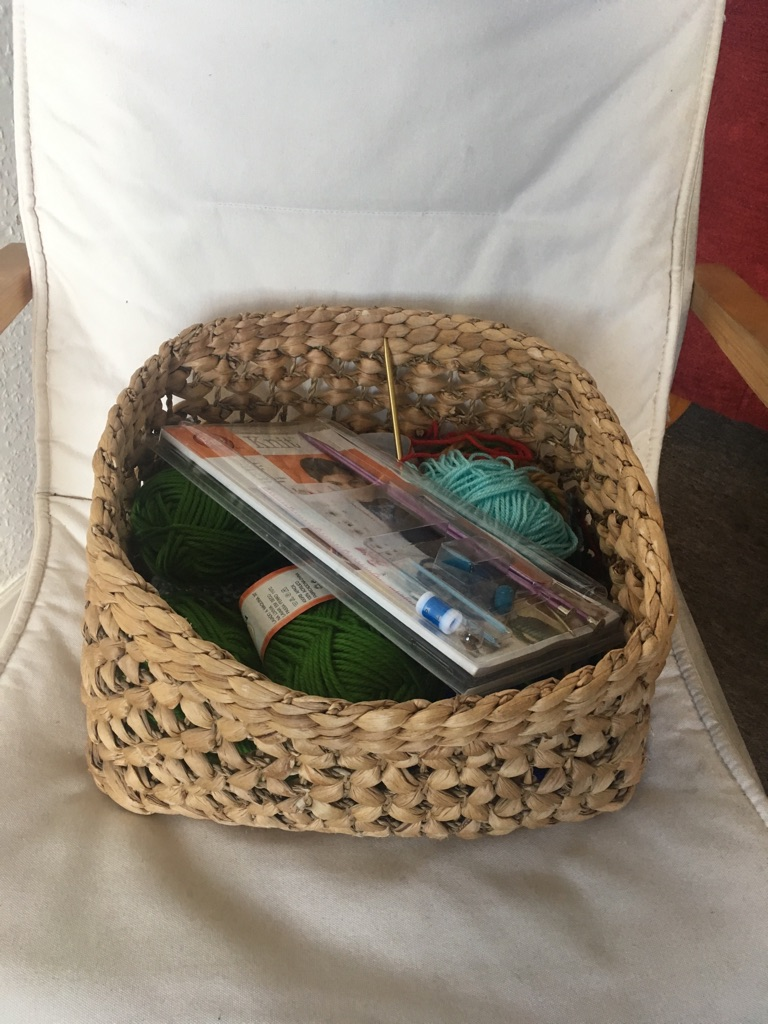 Basket with knitting tools