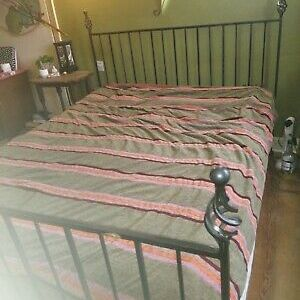 Black king-size wrought iron bed frame