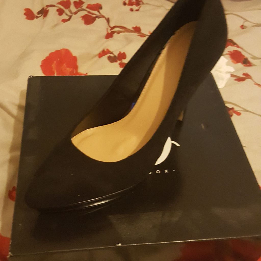 Never been worn black suede heels