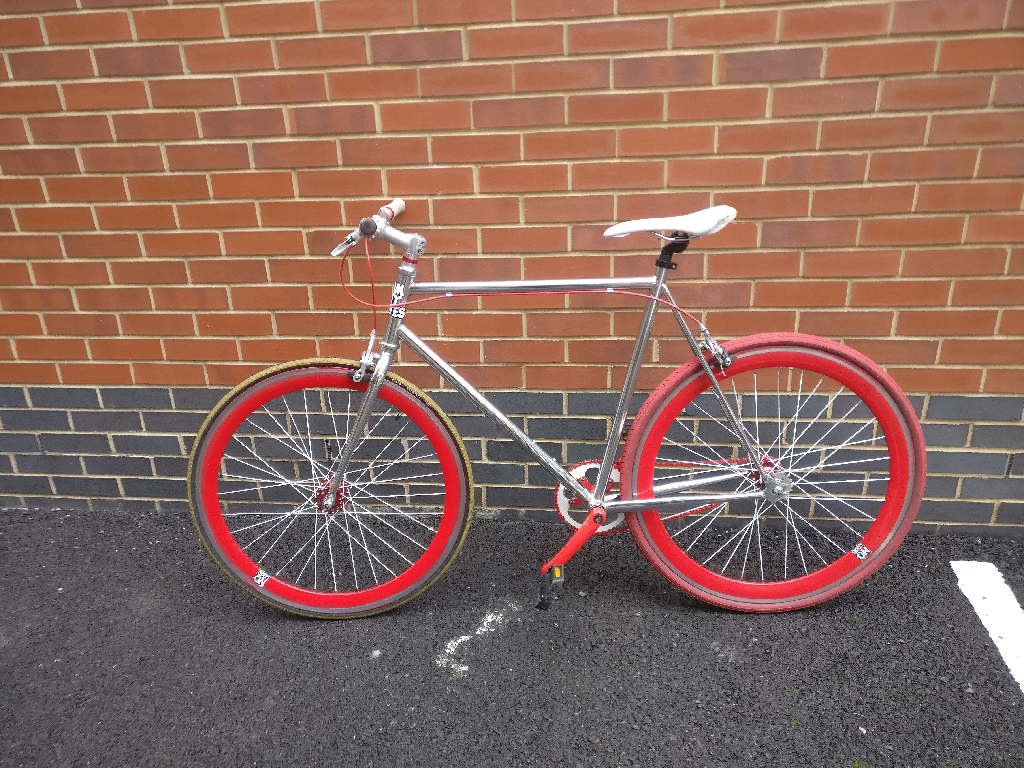 RED AND ALUMINIUM SILVER SINGLE SPEED BIKE