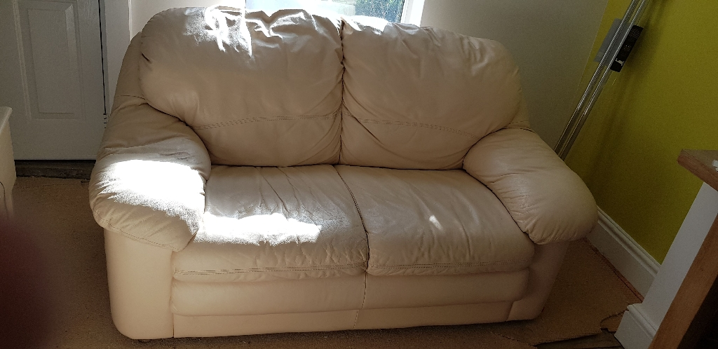 2x Two seater comfortable cream leather sofas