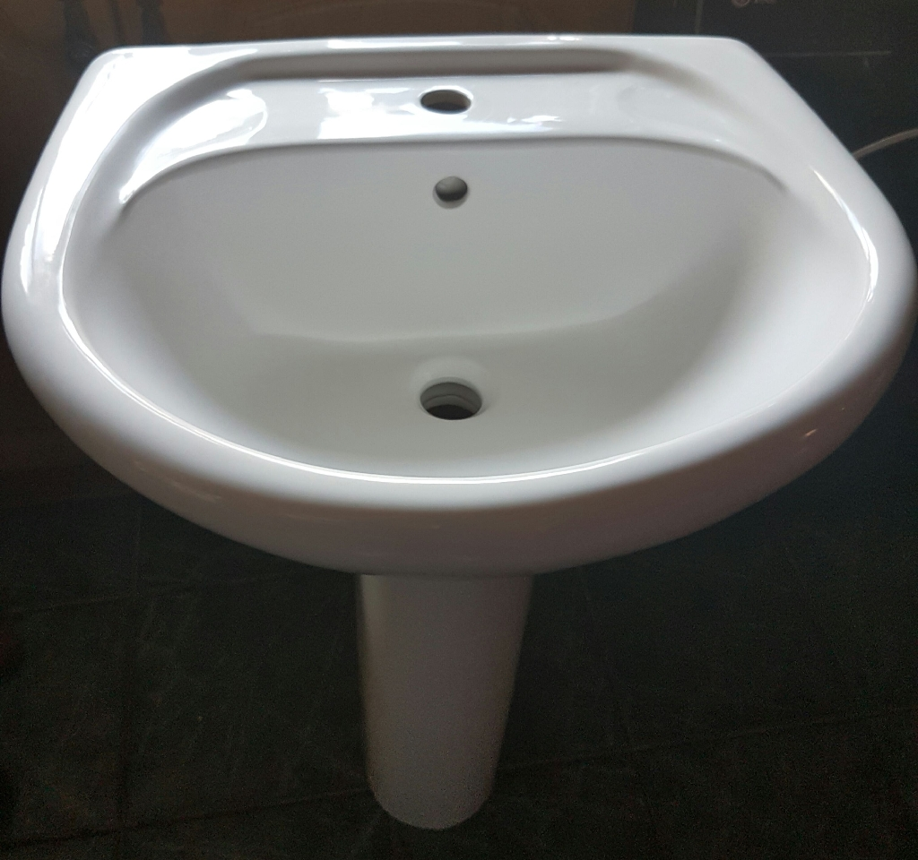 White oval sink and pedestal