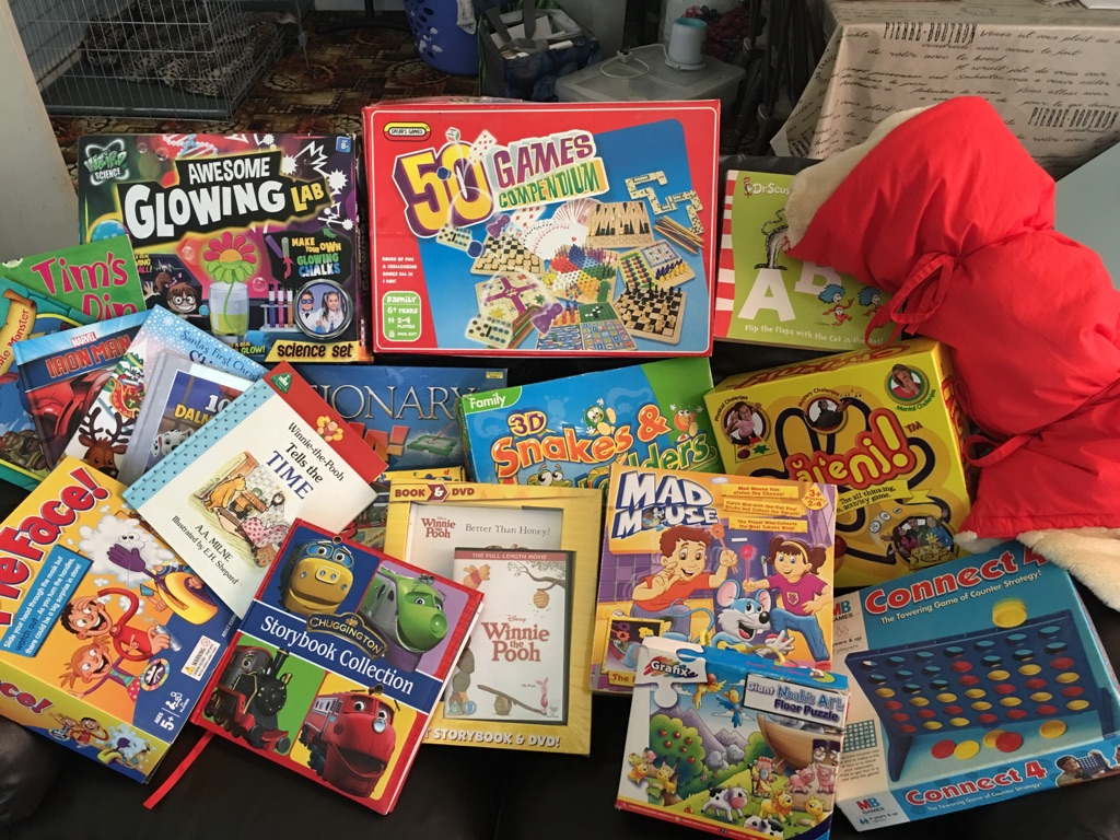 Games and books plus a teddy bear sleeping bag