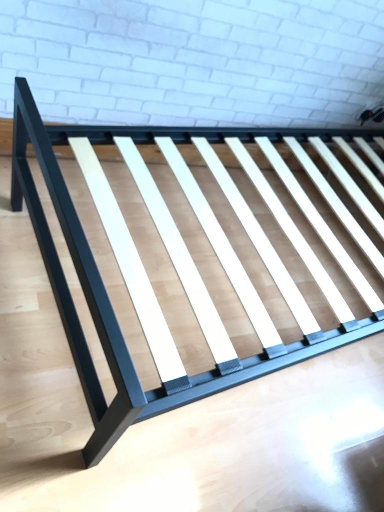 Black metal single bed frame