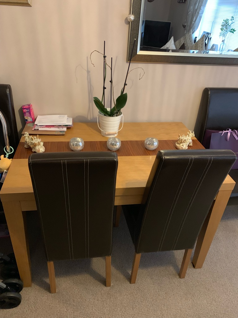 Solid oak table side board and 4 leather chairs