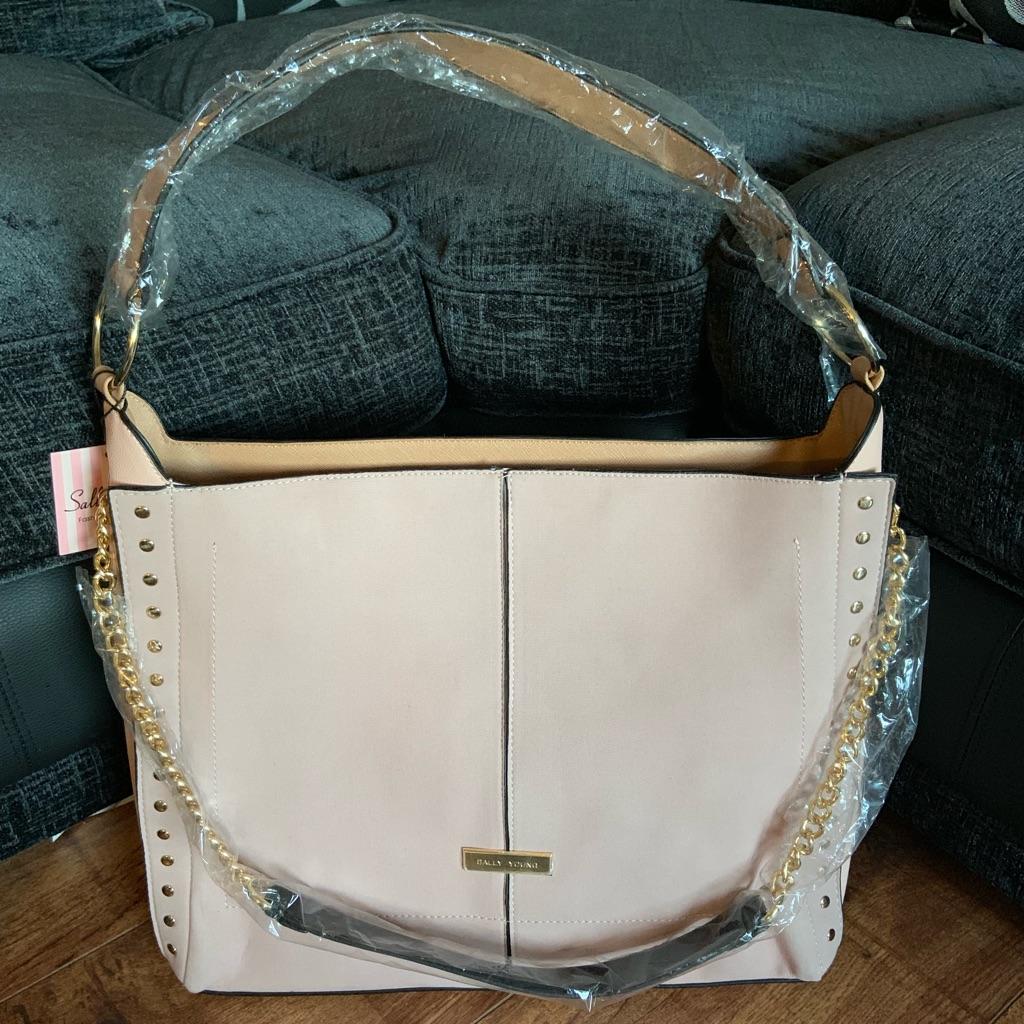 Light pink suede bag
