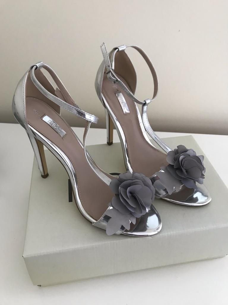 Silver heel shoes