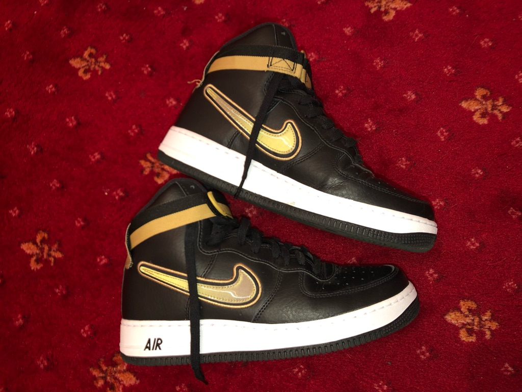 Nike AF 1 black and white with gold Nike symbol