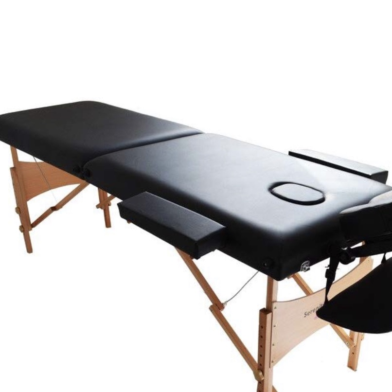 Black massage couch
