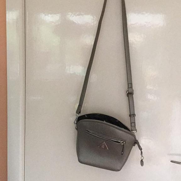 Fly silver cross body bag