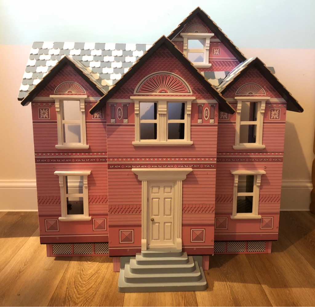 Wooden doll house with wooden furniture