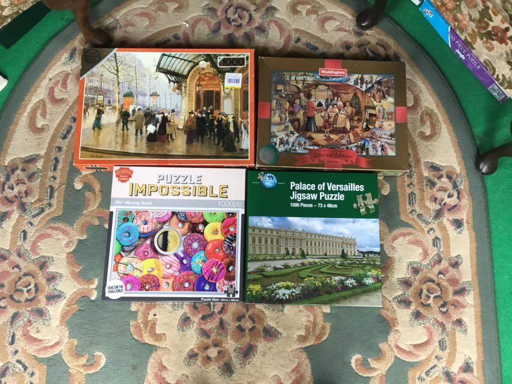 Job lot of 4 puzzles 1000 pieces complete in sealed bag