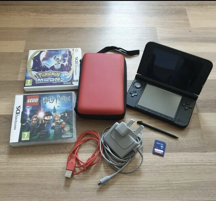 Nintendo XL 3 DS including pokemon moon and Harry Potter.