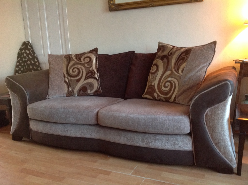 Large sofa and cuddle swivel chair and storage poof
