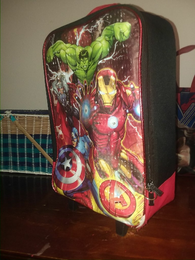 Suit case and back pack. Sold separately.