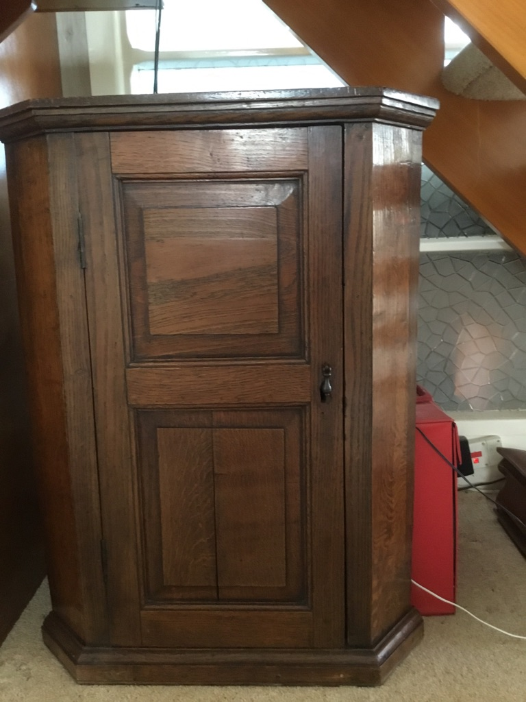 Antique and original oak corner cabinet. Designed to be wall hung.