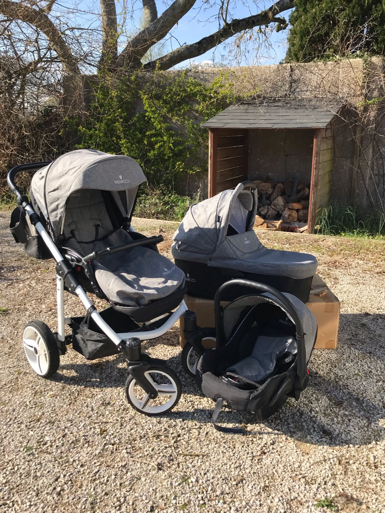 This Venicci 3 in 1 Travel System in grey and white