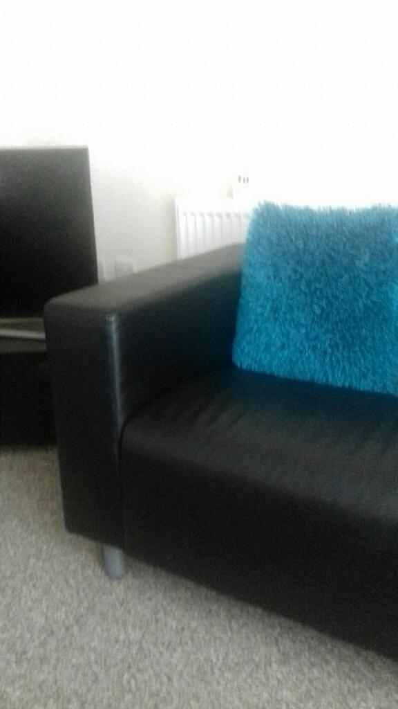 2x2 seater black leather sofas
