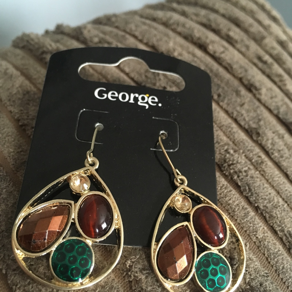 Woman's beautiful brand new earrings from George