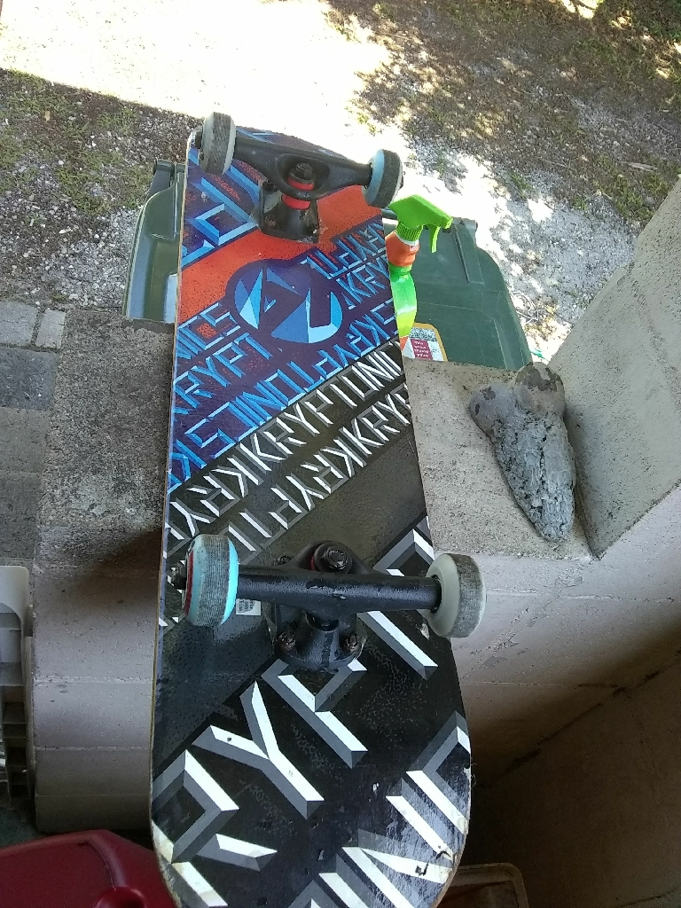 black and gray skateboard deck , blue back