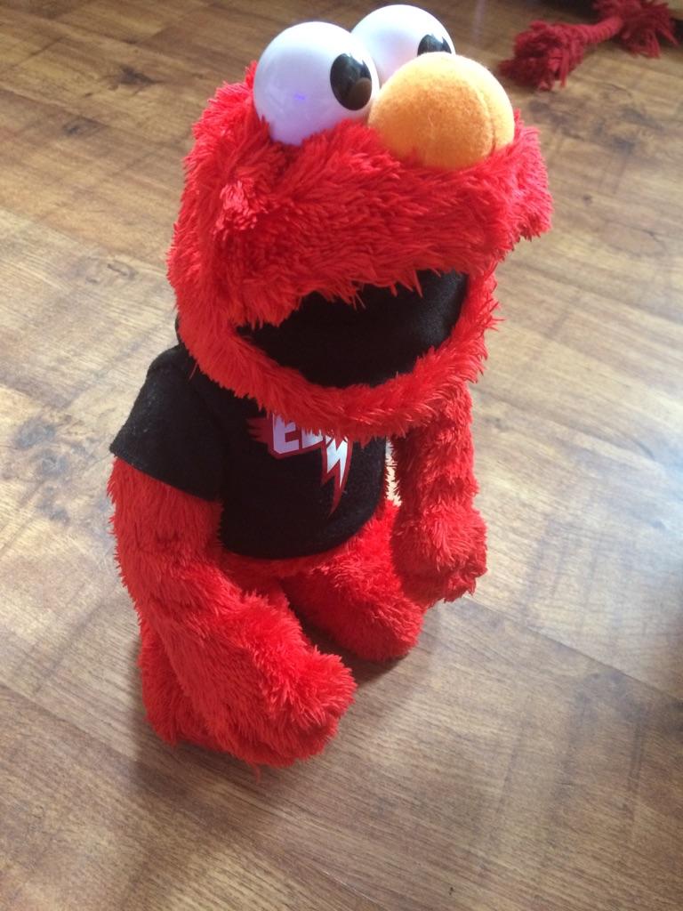 Dancing, talking, singing Elmo (muppets)