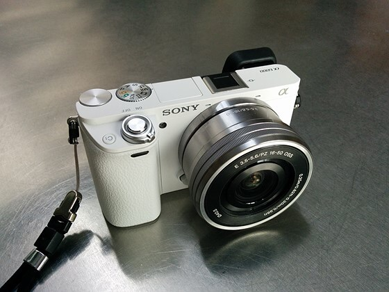 Sony a5100 with memory card and tripod included