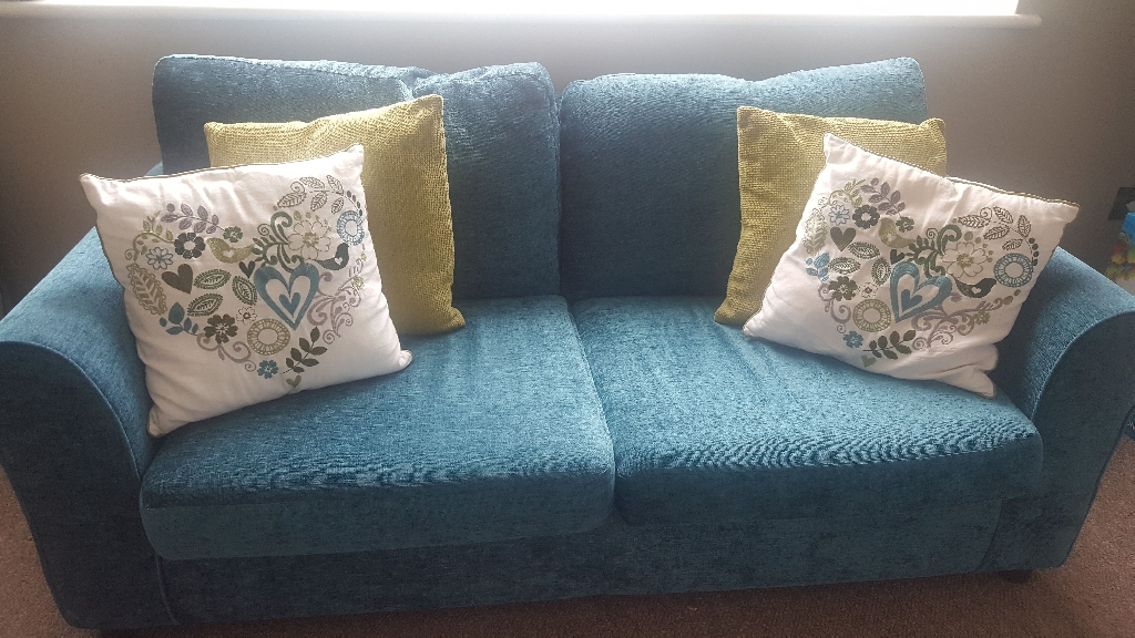 Lovely blue/green sofabeds, dining table & chairs, nest of tables and matching soft furnishings